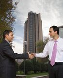 Deal done in the City. Businessmen shaking hands on a deal in front of the Europa building, Madrid, Spain stock image