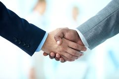 Deal is done. Close-up of business people shaking hands to confirm their partnership Royalty Free Stock Photography