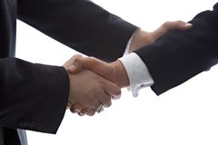 Deal done and signed. Businessmen shaking hands with reassurance and comfort Royalty Free Stock Images