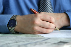 Deal - hand signing contract. Hand with pen is signing a contract Stock Photography