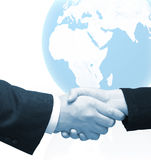 Deal - Handshake. Man and womand hands. A white background with light blue globe could be use as a space for your text Stock Photos