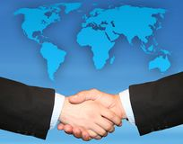 DEAL - HANDSHAKE. Globe and Handshake Stock Photos