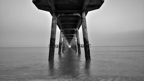 Deal, Kent, underneath the pier. Wanted to capture the columns under the pier in monochrome. 20mm wide angle shot suited. As did the monochrome to isolate the royalty free stock photos