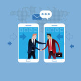 Deal on Mobile phone. Handshake of two business people with cell phone background. Stock Photo