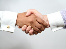 The deal is one!. A business agreement eached between 2 men of different racial backgrounds Stock Photos