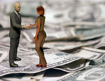 Deal Struck. Man and woman about to shake hands atop US bills Royalty Free Stock Photos