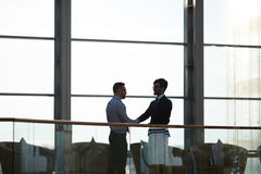 Deal of traders. Two contemporary traders congratulating one another on successful deal Stock Image