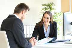 Dealer attending to a customer Royalty Free Stock Photography
