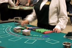 Dealer at blackjack table. Ready for players stock photos