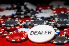 Dealer button and chips Royalty Free Stock Photography