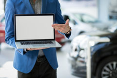 Dealer car shows the best offer. Pointing in blank screen Stock Photography