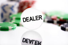 Dealer chip. Dealer and chip on the background Royalty Free Stock Photos