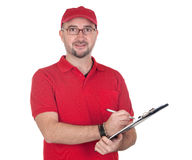 Dealer with clipboard and red uniform. Isolated over white background royalty free stock image