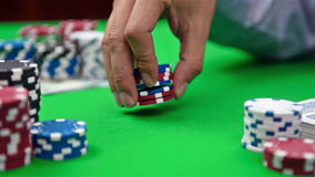 Dealer collects poker chips stock video