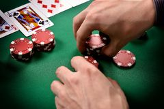 Dealer collects red poker chips Stock Photography