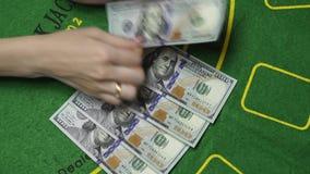 Dealer Counting Money US Dollar Cash In Casino, Background Close Up. Female dealer hands counting money. Hundreds US Dollar bills or notes in cash on Blackjack stock video