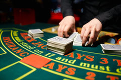 The dealer deals the cards. In a casino Stock Image