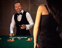 Dealer deals the cards in a casino and laughs Stock Images