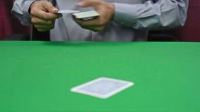 Dealer deals the cards stock video