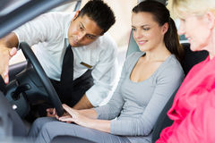 Dealer explaining car customers Stock Image