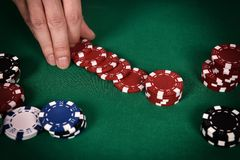 Dealer hands out poker chips Royalty Free Stock Image