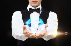 Dealer holding globe on palms of his hands Royalty Free Stock Image
