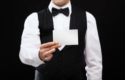 Dealer holding white card Stock Photo