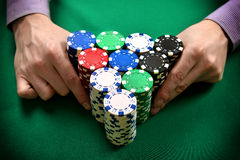 Dealer moves poker chips Royalty Free Stock Photos