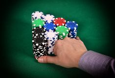 Dealer moves poker chips Stock Image