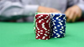 Dealer moves a stack of poker chips stock footage
