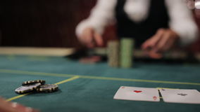 The dealer moves the winning player stock footage