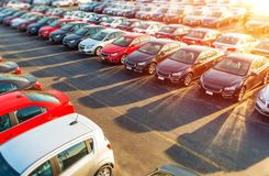 Dealer New Cars Stock. Colorful Brand New Compact Vehicles For Sale Awaiting on the Dealer Parking Lot. Car Market Business Concept stock image