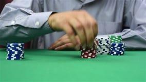 Dealer recounts poker chips stock video
