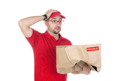Dealer scared for having damaged the box Royalty Free Stock Images