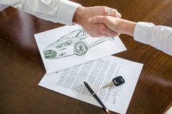 Dealer shaking hands with his customer Royalty Free Stock Photos