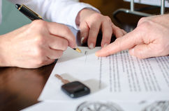 Dealer showing the signature place of a contract Royalty Free Stock Photography