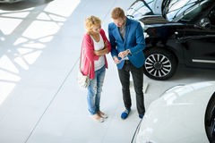 Dealer speaking with a client in a dealership Stock Photo