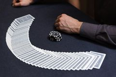 Dealer spreading the deck at poker game Stock Images