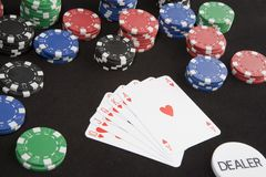 Dealer wins. It all - huge amount of poker chips won with a royal flush - dealer chip suggests cheating royalty free stock photo