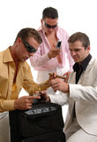 Dealers. Three men testing the purity of drugs before making the deal Stock Images