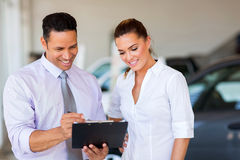 Dealership principal saleswoman Royalty Free Stock Photos