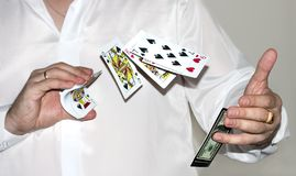 Dealing cards. Man's hands playing with cards Royalty Free Stock Photo