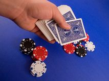 Dealing the Cards. A hand ready to deal the top card during a poker game stock image