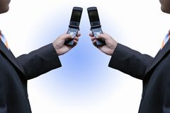 Dealing with cellphones Stock Images