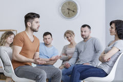 Dealing with communication issues. During group psychotherapy meeting royalty free stock image