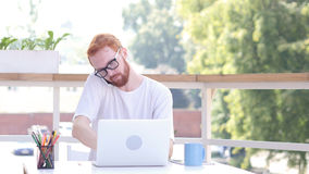 Dealing with Customers, Phone Talk, Sitting in Outdoor Office, Red Hairs Royalty Free Stock Images