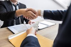 Dealing greeting and partnership meeting concept, businessmen handshaking after finishing up deal contract for both companies. Dealing greeting and partnership stock photos