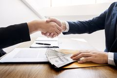 Dealing greeting and partnership meeting concept, businessmen handshaking after finishing up deal contract for both companies.  stock photos
