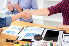 Dealing greeting and partnership meeting concept, businessmen handshaking after finishing up deal contract for both companies.  stock photography