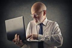Dealing with a laptop Stock Photos